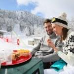 Skiers having snack — Stock Photo #67894055