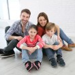 Family sitting on floor — Stock Photo #67894455
