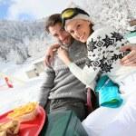 Skiers having snack — Stock Photo #67894553