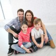Family sitting on floor — Stock Photo #67894853