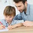 Daddy with boy making drawings — Stock Photo #67895451