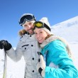 Couple of skiers at ski slope — Stock Photo #67895975