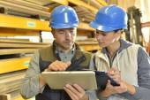 Worker with overseer controlling stock — Stock Photo