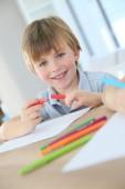 Boy making drawing — Стоковое фото