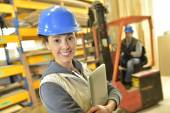 Woman working in warehouse — Stock Photo