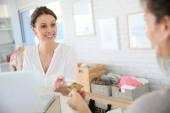Customer giving credit card to seller — Stock Photo