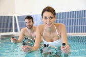Couple doing aquabike training — Stock Photo
