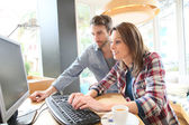 Couple websurfing on desktop computer — Stock Photo