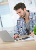 Businessman at home working on laptop — Stock Photo