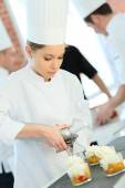 Pastry cook spreading whipped cream — Stock Photo