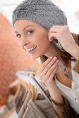 Girl trying earings on — Stock Photo