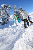 Skiers walking on track — Stock Photo