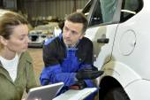 Mechanic with insurance adjuster — Stock Photo