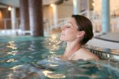 Woman in spa swimming-pool — Stock Photo