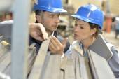Supplier with engineer checking on production — Stock Photo