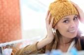 Woman trying hat on — Foto de Stock