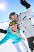 Couple having fun in snow — Stock Photo