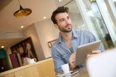 Man websurfing on digital tablet — Stock Photo