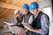 Construction manager with workers — Stock Photo