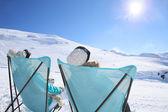 Skiers sunbathing at ski slope — Stock Photo