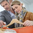 Couple shopping in clothing store — Stock Photo #70975479