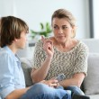 Mother giving warning to boy — Stock Photo #70975693