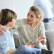 Mother giving warning to boy — Stock Photo #70976065