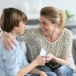 Mother giving money to adolescent — Stock Photo #70976791
