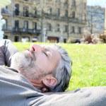 Man having nap in park — Stock Photo #70977335