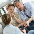 Parents giving smartphone with warning — Stock Photo #70977417