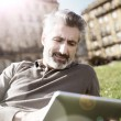 Man connected on tablet in park — Stock Photo #70977707