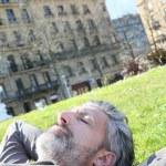 Man having nap in park — Stock Photo #70978895