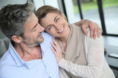 Embracing couple at home — Stock Photo