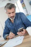 Teacher using laptop and smartphone — Stock Photo