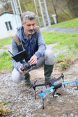 Man operating drone — Stock Photo