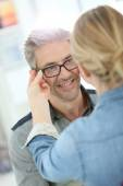 Man trying eyeglasses on — Stock Photo