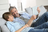 Daddy and son websurfing — Stock Photo