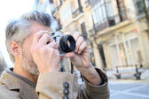 Photographer taking pictures — Stock Photo