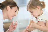 Girl receiving injection — Foto Stock