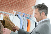 Man choosing clothes — Stock Photo