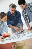 Students with trainer working on architecture project — Stock Photo