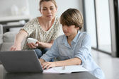 Mother looking after son — Stock Photo