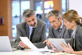 Business people at financial meeting — Stock Photo