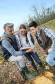 Teacher with students in environment sciences — Stock Photo