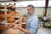 Carpenter standing in workshop — Stock Photo