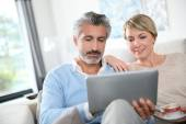 Couple websurfing on touchpad — Stock Photo