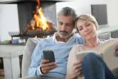 Couple using smartphone — Stock Photo