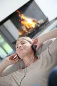 Woman listening to music — Stock Photo