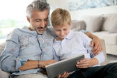Father and son using tablet — Stock Photo