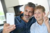 Father and son taking picture of themselves — Stock Photo
